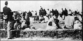 Old photo of Navajo people being kept by force at Bosque Redondo near Fort Sumner